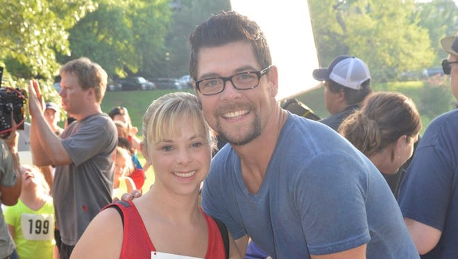 Ashley DeRamus, left, and Jason Crabb pose on the set of Crabb's 'Love Is Stronger' video.