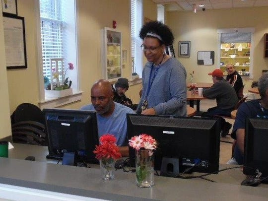 A resident at Tender Mercies getting training on how to use a computer.