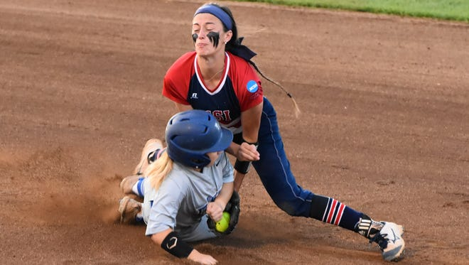 University of Southern Indiana's Lexi Reese puts the tag on West Florida's Meghan Toney in the top of the first inning Friday night in the NCAA Division II World Series. Toney was thrown out trying to steal a base for just the third time in 29 attempts this season.