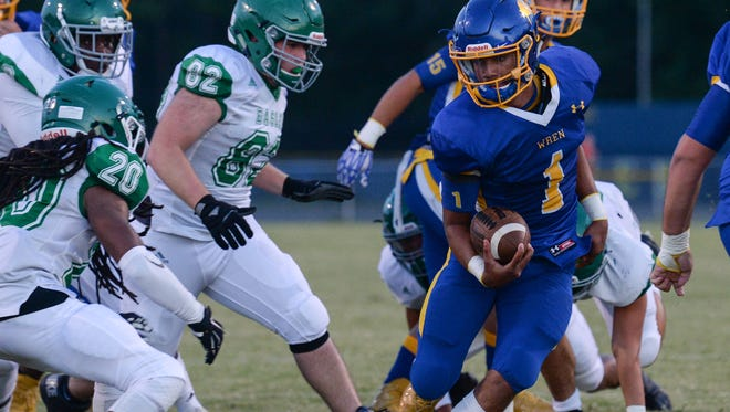 Wren junior Tyrell Jackson (1) runs in a touchdown near Easley quarterback Darius Jamison (20) during the first quarter at Wren High School in Piedmont on Friday.