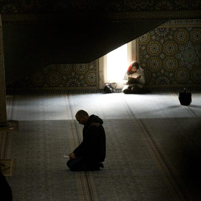 A man prays in the Rome's main mosque on Jan. 22. Muslim leaders have declared that the religious freedom of minority faiths must be protected in Muslim majority nations.