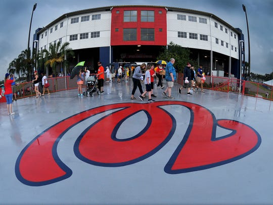 Disappointed fans leave the stadium after the Nationals last game held at Space Coast Stadium in Viera was rained out.