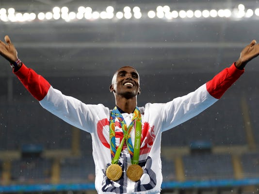 FILE - In this Aug. 20, 2016, file photo, Britain's Mo Farah celebrates winning the gold medal at the men's 5000-meter medals ceremony, during the athletics competitions of the 2016 Summer Olympics at the Olympic stadium in Rio de Janeiro, Brazil. Data posted by Russian-linked hackers show four-time Olympic gold medalist runner Mo Farah's blood readings were once flagged by track's governing body.(AP Photo/Jae C. Hong, File)
