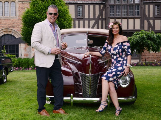 Scott Ferguson and Renee Godin enjoy the classic cars, cigars and wine at The Garden Party.