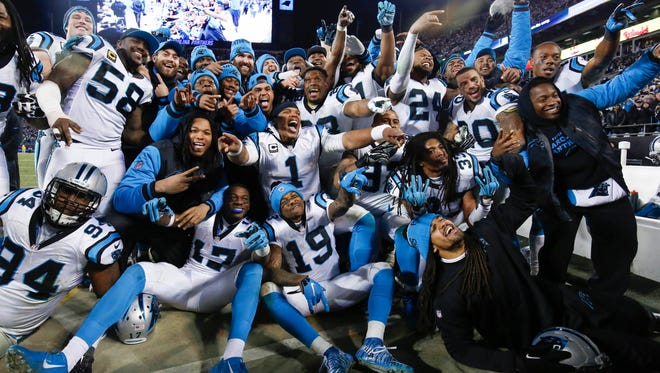 Carolina Panthers team members pose for a photo during the fourth quarter against the Arizona Cardinals in the NFC Championship football game at Bank of America Stadium.