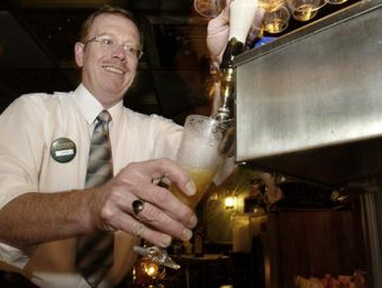 Kevin Stafford draws a draft beer at The Surf in 2005.
