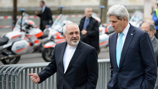 US Secretary of State John Kerry speaks with Iranian Foreign Minister Mohammad Javad Zarif, (L), in Geneva in January 2015, during a bilateral meeting ahead of the next round of nuclear discussions. Supporters of the country point to its demonstrations of good faith and hope for a resolution to the talks this month.