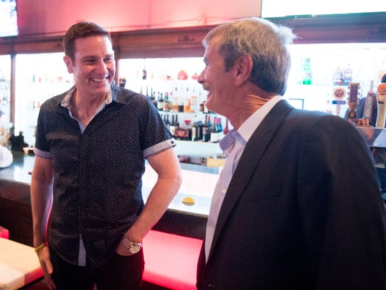 Actor Carl Marino, left, of Homicide Hunters is greeted