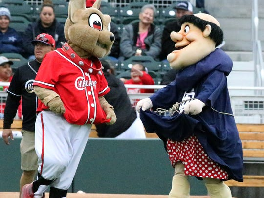 Chico, the El Paso Chihuahuas mascot and the San Diego Padres mascot frolic on the field at the start of an exhibition game Monday.