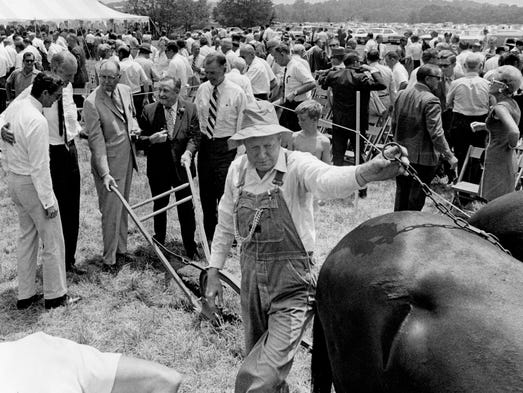 Pete Kirby, center, better known as Bashful Brother Oswald, hooks up the trace chains for the groundbreaking of Opryland USA theme park on June 30, 1970. Doing the groundbreaking honors are MacDonald Becket, left, of Welton Becket and Associates Architects of Los Angeles; National Life President William C. Weaver; Gov. Buford Ellington; Mayor Beverly Briley; and National Life and WSM Board Chairman Dan Brooks.