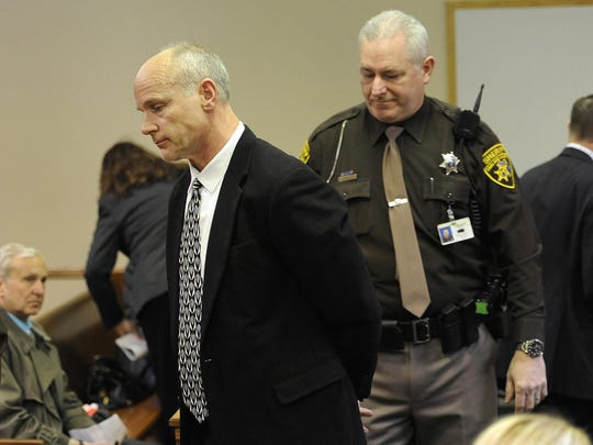 An Oakland County Sheriff's Deputy escorts Michael Skupin, left, out of the courtroom of Judge Kelley Kostin at 52-2 District Court, after Kostin determined that Skupin violated her order of not using the internet.