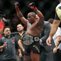 Oct 3, 2015; Houston, TX, USA; Daniel Cormier (red gloves) celebrates after defeating Alexander Gustafsson (not pictured) after their World Light Heavyweight Championship at UFC 192 at Toyota Center. Mandatory Credit: Troy Taormina-USA TODAY Sports