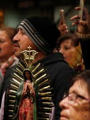 "Catholics walk the 17th annual ""Walk of Faith' from"