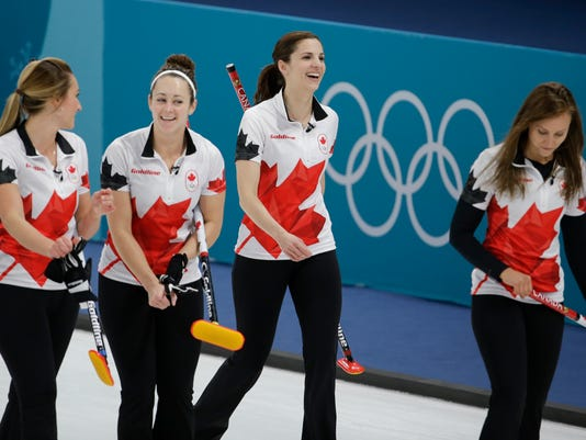 Canada team leaves after winning a women's curling match against United States at the 2018 Winter Olympics in Gangneung, South Korea, Saturday, Feb. 17, 2018. (AP Photo/Natacha Pisarenko)