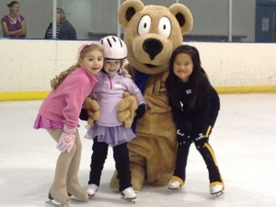 Children left to right:  Maia Whyte, Penelope Kincade, Sophie Mackens -- with Snowplow Sam, the mascot for US Figure Skating's learn-to-skate program. Photo by Becca Hatch-Purnell
