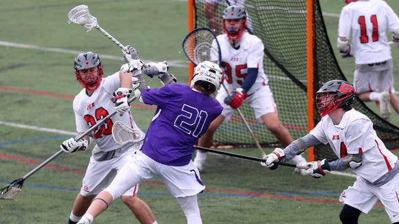 John Jay's Dean Ford (21) fires a shot for a second