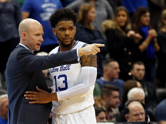 Seton Hall head coach Kevin Willard, left, talks with Seton Hall guard Myles Powell against St. John's.