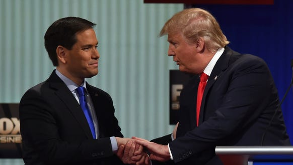 Marco Rubio and Donald Trump shake hands after a GOP