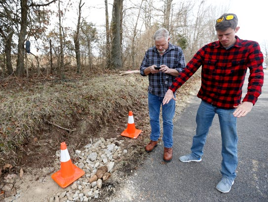 Eric Talbert shows about how far back a sinkhole located