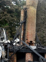A portion of brick chimney is all that remains after a July fire destroyed the Governor's Mansion in Opelousas.