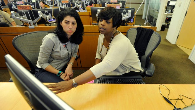 CDC employees Chastity Walker, right, and Alyse Finkel analyze Ebola details in the Emergency Operations Center in Atlanta.