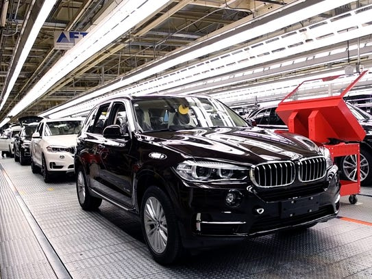 BMW X5 vehicles roll off the assembly line at the BMW