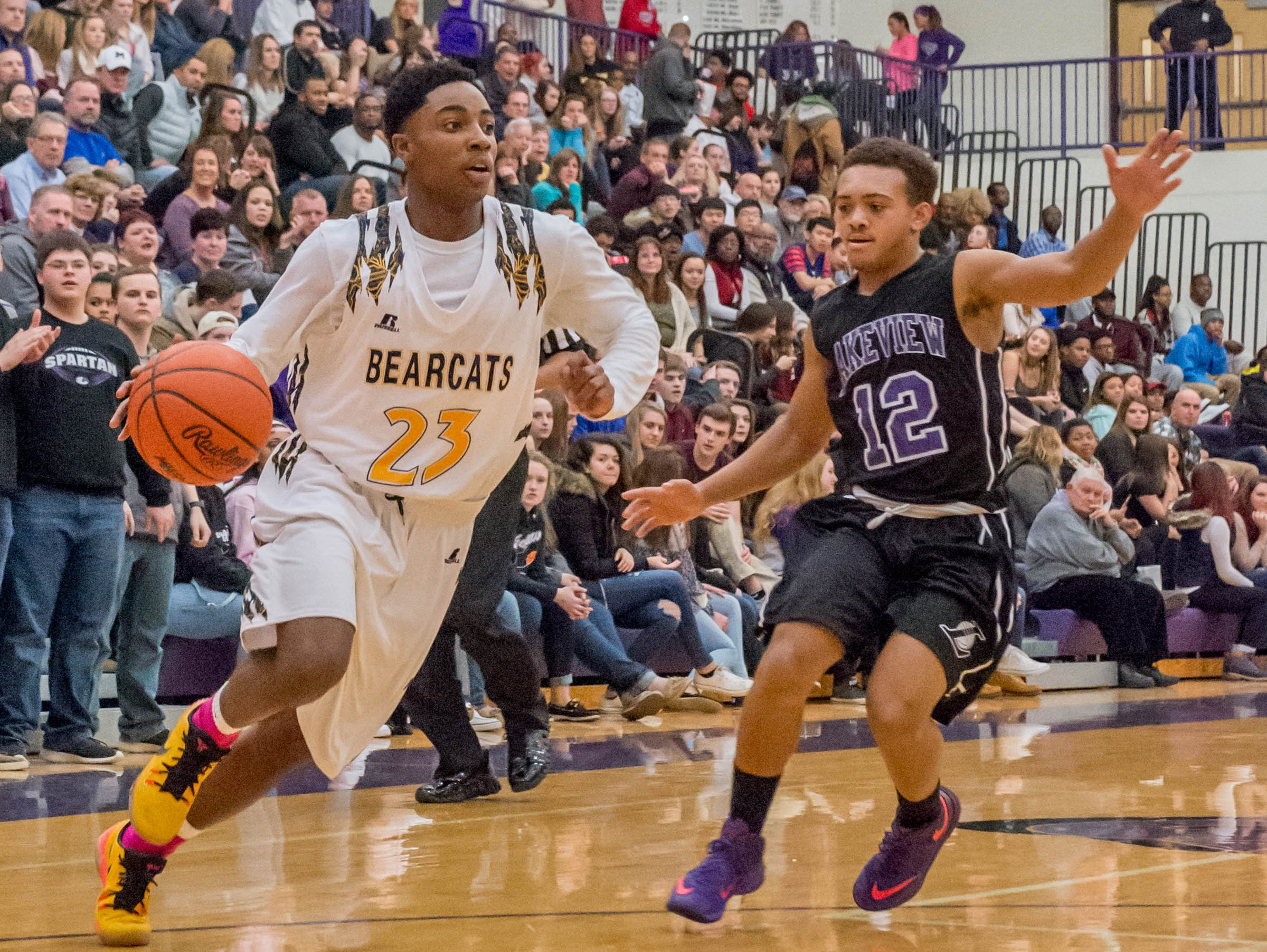 Battle Creek Central's Dontell Hardy (23) drives to the basket past Lakeview's CJ Foster (12) during Friday evening's game.