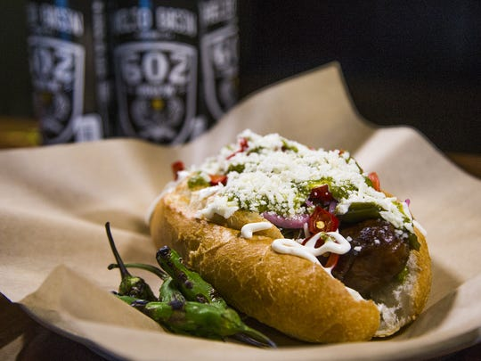 The Sonoran sausage with Helio Basin 602 Brew at Helio Basin Brewing Co. in Phoenix, Thursday, May 31, 2018.