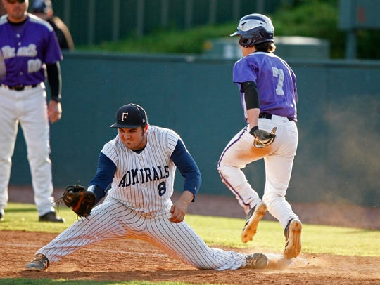 Farragut first baseman Chase Chambers stretches to get Sevier County's Dalton Ford out on May 16, 2014.