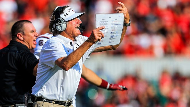 South Carolina Gamecocks head coach Steve Spurrier reacts to a play in the first half against the Georgia Bulldogs at Sanford Stadium.