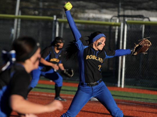 Bloomfield's Thalia O'Neil pitches during the game between the Lady Bobcats and the San Juan Lady  Broncos on March 12 at the Bloomfield Softball Complex.