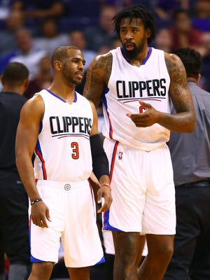 Los Angeles Clippers guard Chris Paul (3) and center DeAndre Jordan (6) against the Phoenix Suns at Talking Stick Resort Arena.