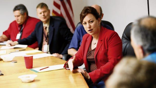 New Mexico Education Secretary Hanna Skandera listens as Farmington Municipal School District board members speak during a board work session on Thursday at the district's office in Farmington.