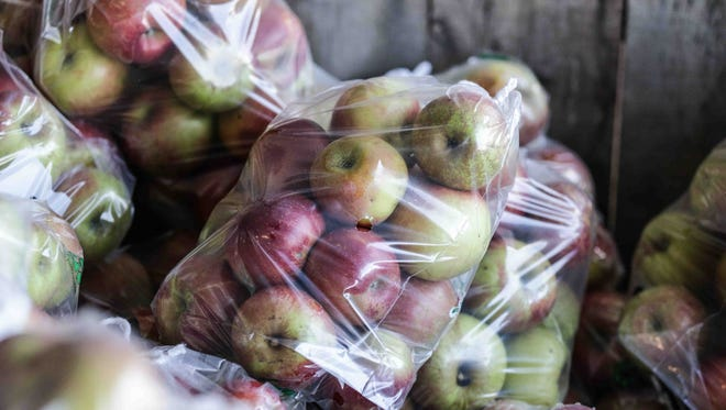 Apples are packaged for sale.