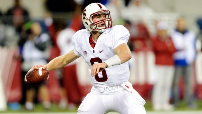 Stanford Cardinal quarterback Kevin Hogan passes the ball against the Washington State Cougars at CenturyLink Field.