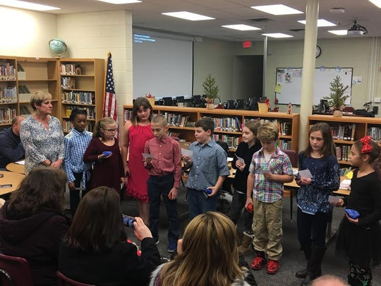 Netcong Elementary School students explain their Kindness for Christopher pajama drive to the board of education on Dec. 13. From left, teacher Kim Arbolino, and students Gabriella Quarranttey, Janelle Marks, Emily Platt, Robert Hathaway, Tyler Seibert, Sofia O'Connor, Aris Zajaczkowski, Bella Hoffman, Gianna Santana.