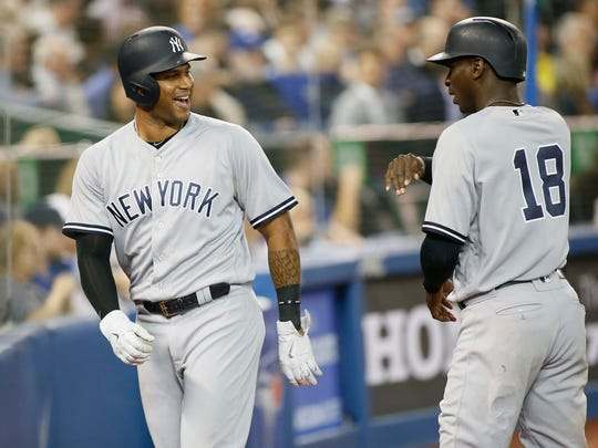 Jun 5, 2018; Toronto, Ontario, CAN; New York Yankees center fielder Aaron Hicks (31) reacts after scoring on a grandslam homerun by third baseman Miguel Andujar (not pictured) against the Toronto Blue Jays in the seventh inning at Rogers Centre.