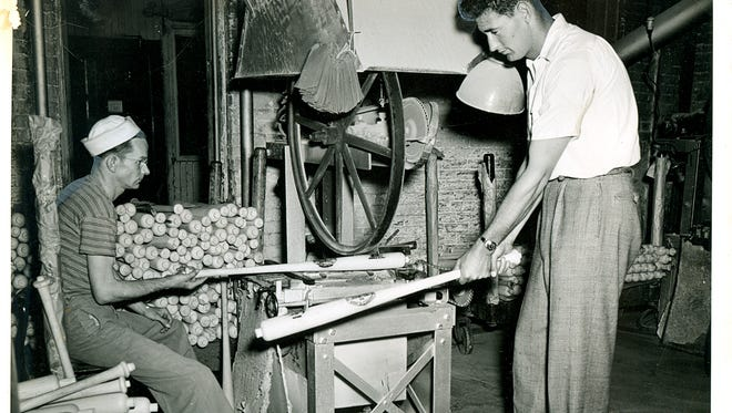 Louisville Slugger  Hall of Famer Ted Williams visits the bat factory in Louisville in the 1940s. Hall of Famer Ted Williams visits the bat factory in Louisville in the 1940s.
