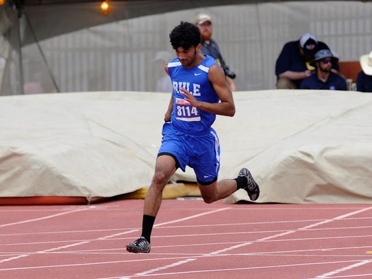 Rule's Chase Thompson turns the corner during the Class 1A boys 400-meter dash at the UIL State Track and Field Championships at the University of Texas' Mike A. Myers Stadium on his way to the gold medal with a time of 49.69 seconds.