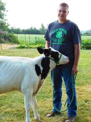 Paul Mowry, a member of the Busy Beavers 4-H Club, is taking two dairy beef feeders to the fair in August.