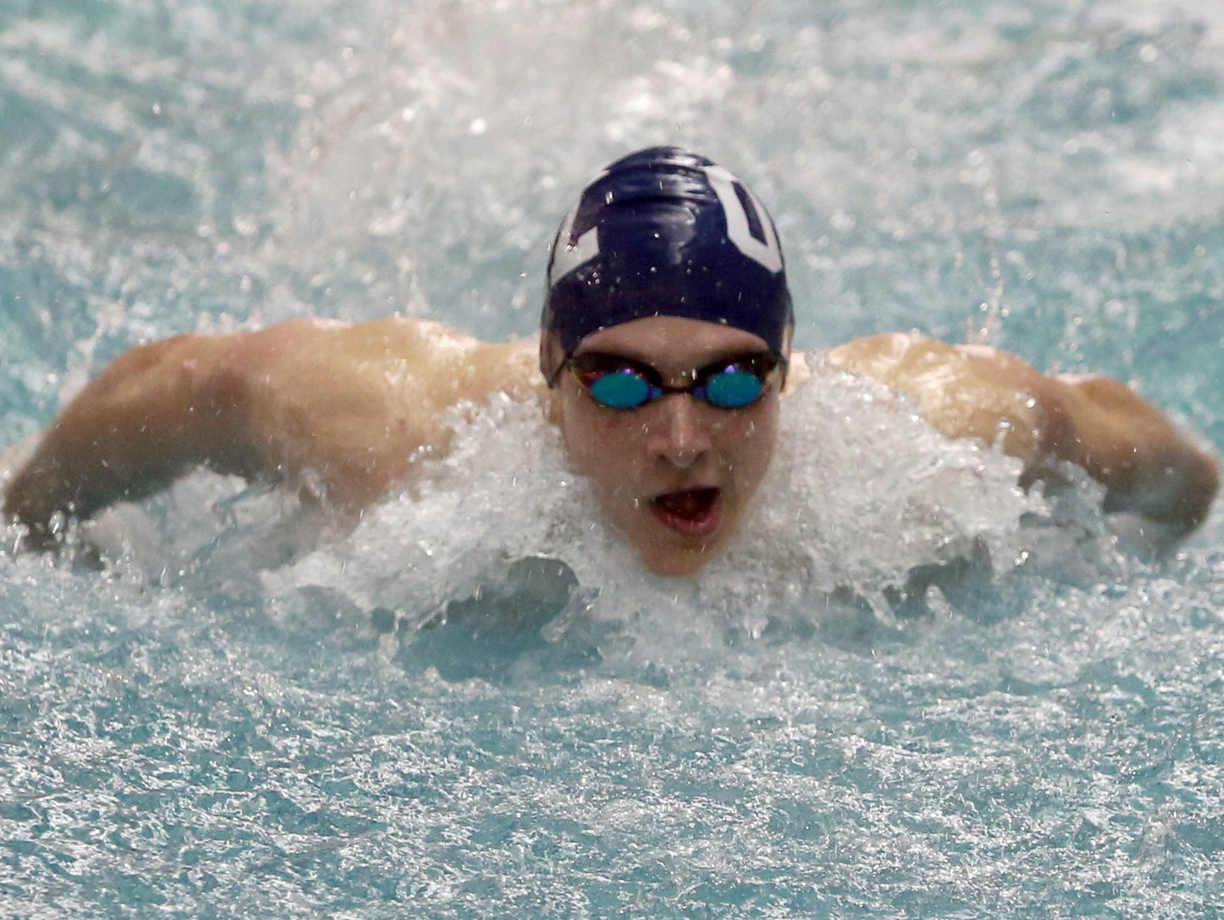 Christian Thomas of Our Lady of Lourdes competes in the 200-yard individual medley event at the Section 1 swimming championships at Felix Festa Middle School in West Nyack on Wednesday. Thomas finished in second place.
