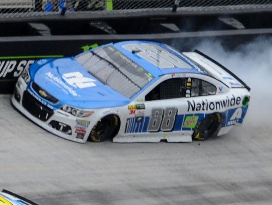 Dale Earnhardt Jr. smacks the wall during the Food