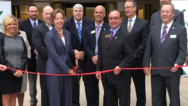 Officials from Veritiv and several other organizations posed for a photo outside the company's Fairfield operations center on Monday, Nov. 28, 2016. Among those attending the ceremony were (left to right) Kimm Coyner of the Regional Economic Development Initiative Cincinnati; Justin Krueger, chief operating officer of Mercy Health – Fairfield City Hospital; Karl Rockenhaus, vice president of customer service at Veritiv; Mary Laschinger, chairman and CEO of Veritiv; Kert Radel, president and CEO of the Fairfield Chamber of Commerce; Mark Wendling, Fairfield city manager; Steve Miller, Fairfield mayor; Mike Sewell, chief financial officer of Cincinnati Financial; Blake Slater of Cincinnati Financial and Bill Woeste, Fairfield city councilman.