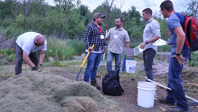 Students of the 2017 Midwest Compost School, hosted at UW-Stevens Point by WIST and the Soil and Waste Resources Discipline July 11-13, build compost piles as part of a field exercise. The school is one of the ongoing sustainability initiatives offered through these two units.