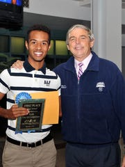First-place high school award winner Kyandre Holifield with Jackie Pons