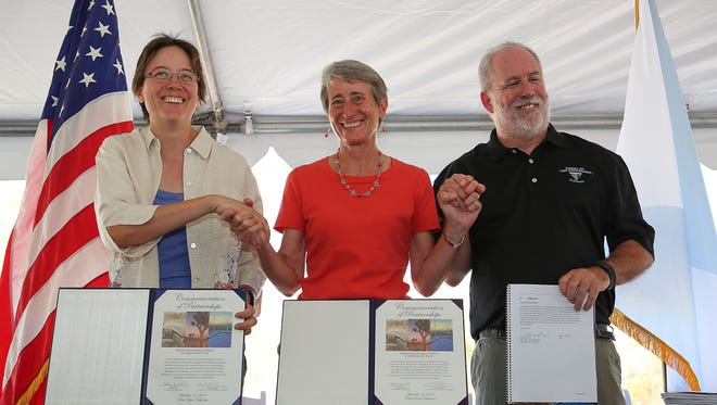 From left, California Energy Commissioner Karen Douglas, Interior Secretary Sally Jewell and California BLM Director Jerry Perez celebrate the signing of the Desert Renewable Energy Conservation Plan on Sept. 14, 2016 at the Santa Rosa and San Jacinto Mountains National Monument Visitor Center in Palm Desert.