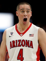 Arizona guard T.J. McConnell yells at his bench on January 28, 2015.