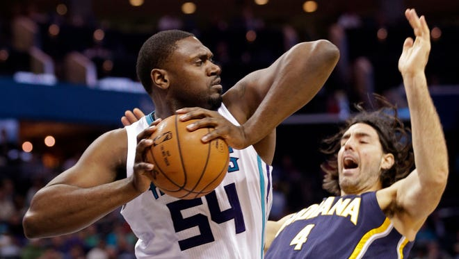 Charlotte Hornets' Jason Maxiell grabs a rebound over Indiana Pacers' Luis Scola during the first half of an NBA basketball game in Charlotte, N.C., Sunday, Feb. 8, 2015.