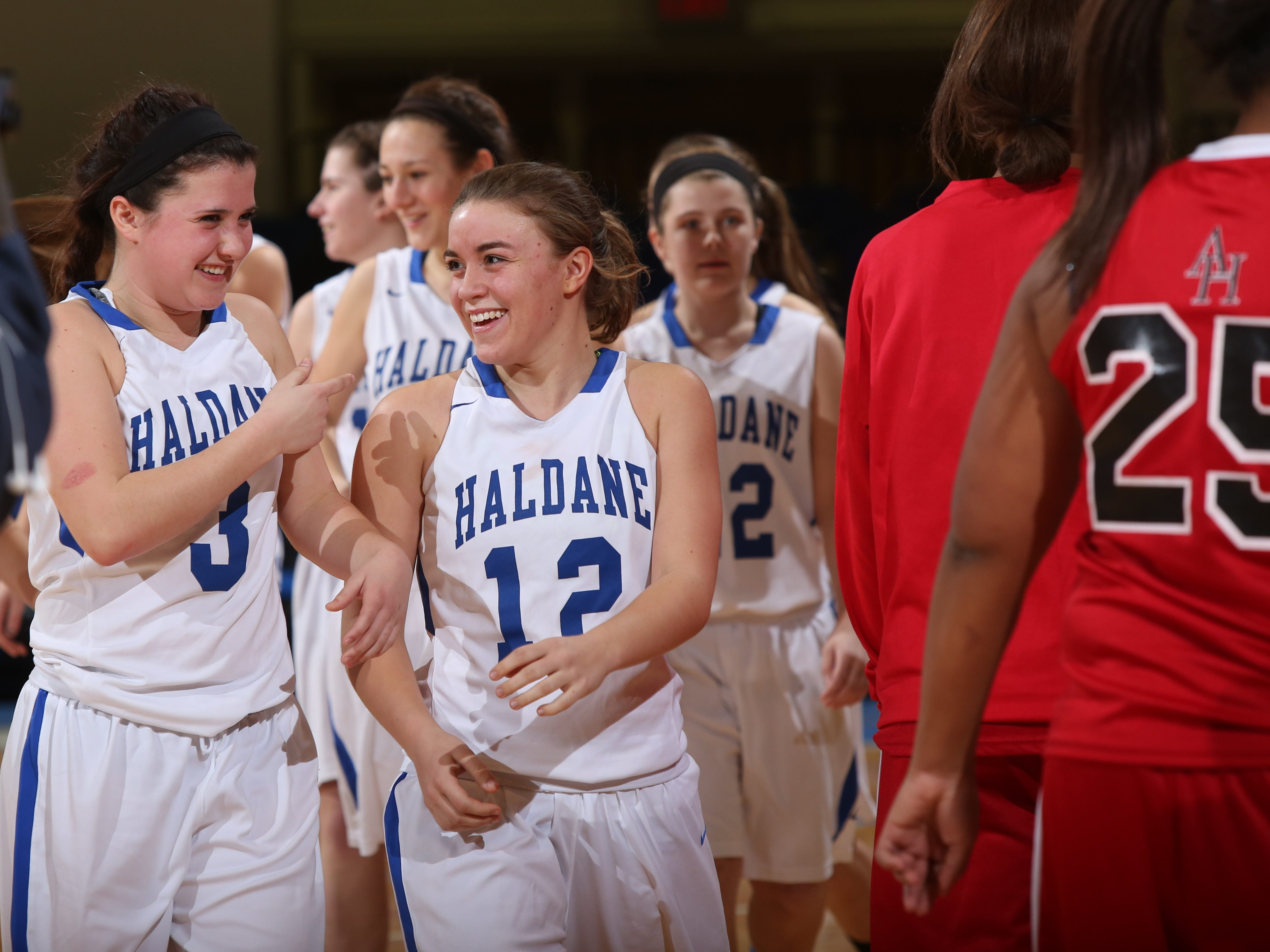 No.1 Haldane's Hannah Monteleone (3) and Marissa Lisikatos (12) celebrates their 60-38 victory over No. 2 Hamilton during the Class C girls basketball championship at The Westchester County Center in White Plains Feb. 28, 2015.
