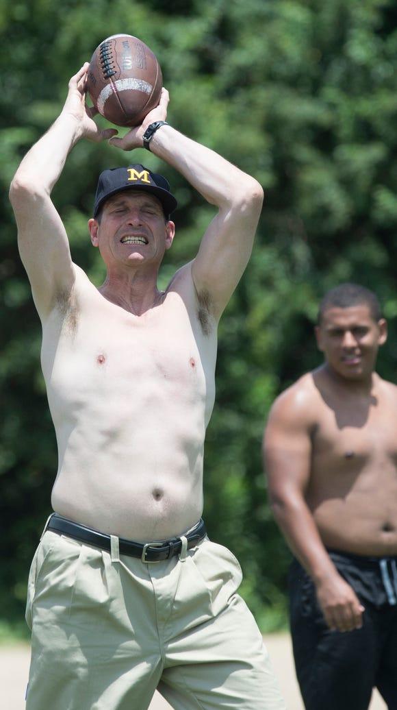 Michigan Head Coach Jim Harbaugh plays shirtless with